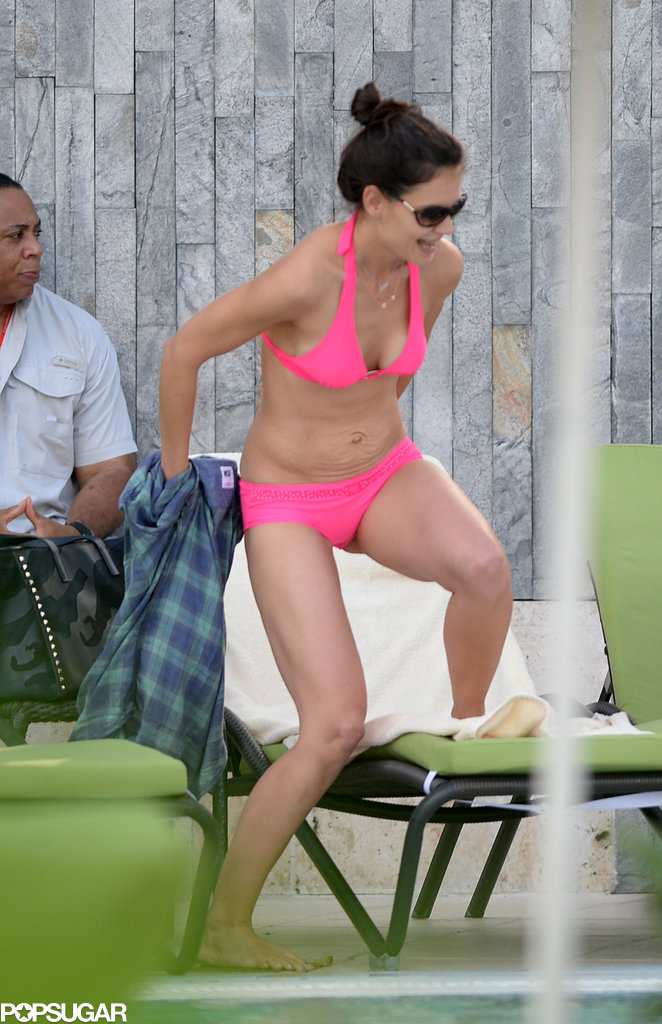 Katie sported a hot-pink bikini while on vacation with Suri.
