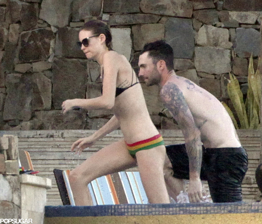 Behati Prinsloo and Adam Levine hung out in the pool during their vacation in Mexico.