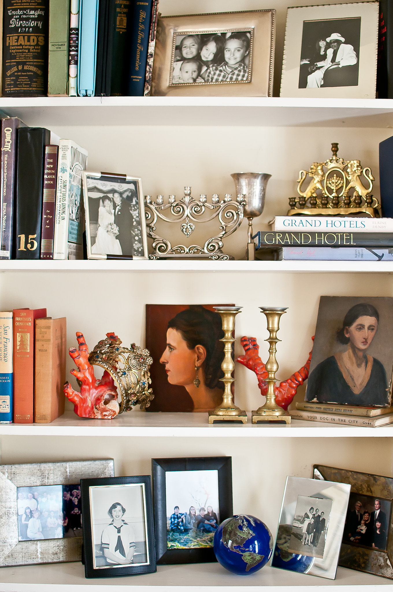 Lynn's shelves are filled with a mix of pretty antique accessories, family photos, and books. Source: Kassie Borreson