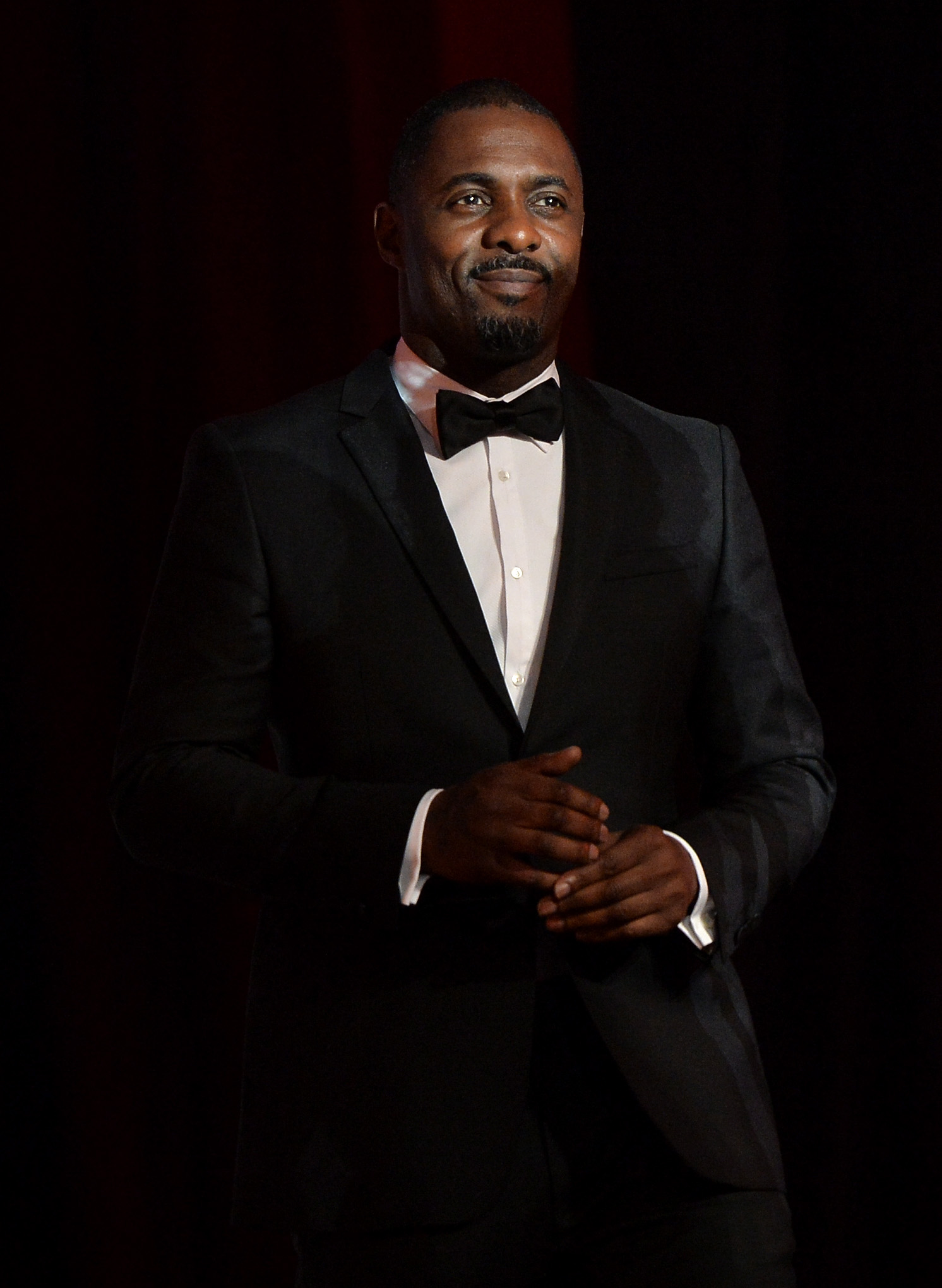 Idris Elba honored U2, who wrote an original song for his film Mandela: Long Walk to Freedom.