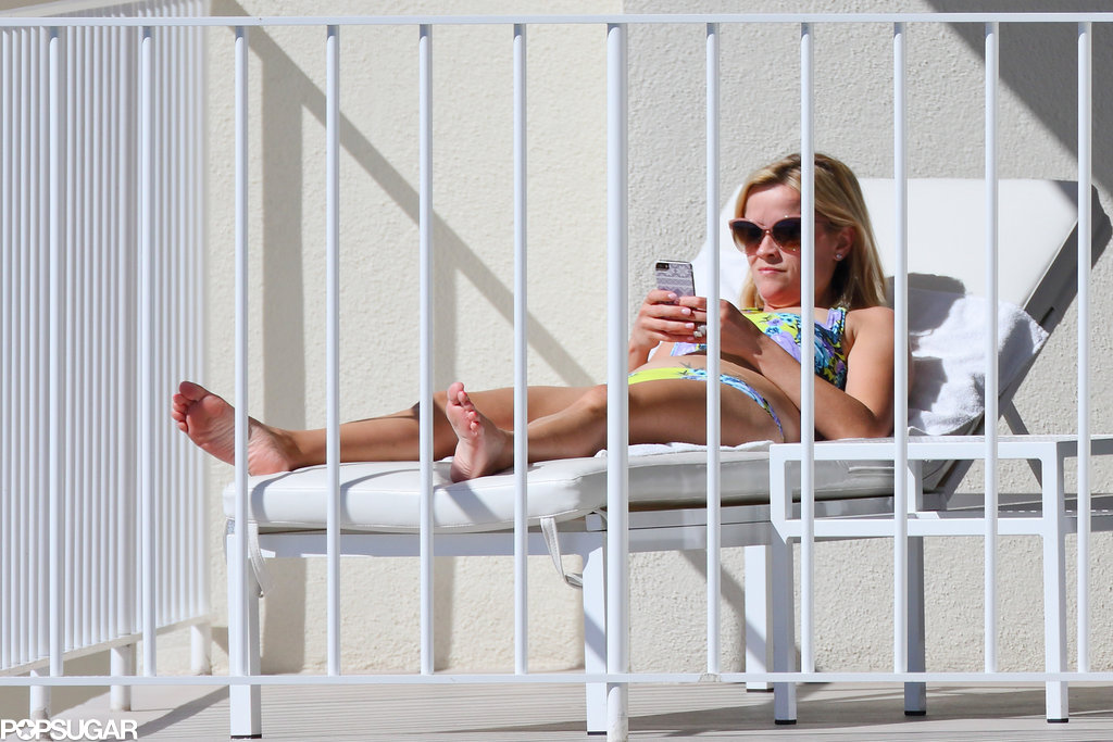 She checked her phone in the sun.