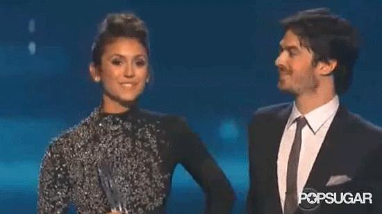 Ian Somerhalder planted an adorable kiss on Nina Dobrev after they picked up the honor for favorite onscreen chemistry — and fans went wild.