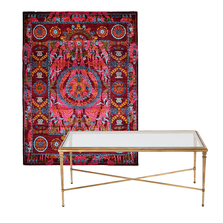 Eclectic is made glamorous with this pair. This colorful rug ($4,526, originally $21,299) makes a statement that will infuse your space with style, especially when matched with this delicate coffee table ($629, originally $749).