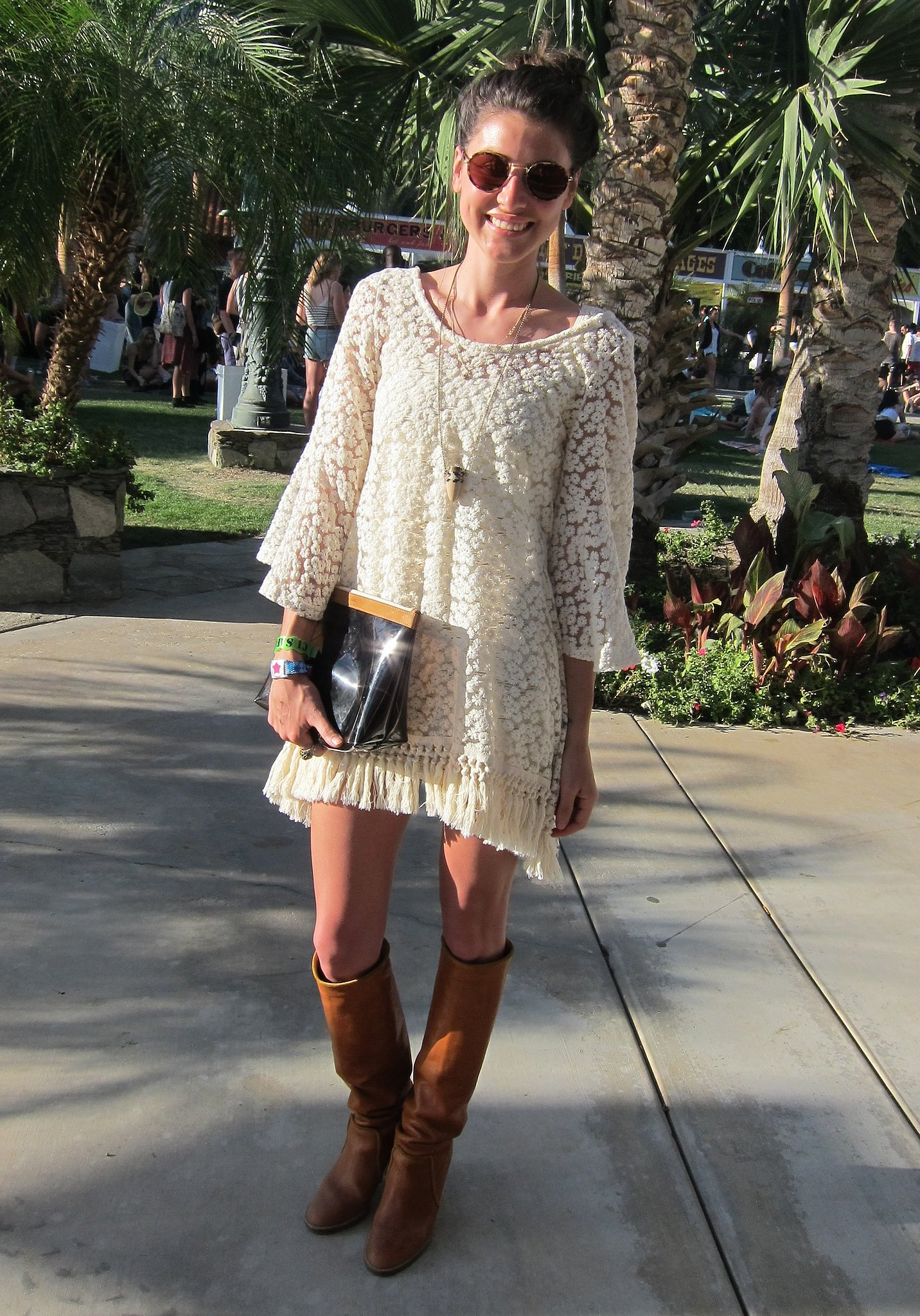 This festivalgoer looked '70s cool in a lace dress and knee-high boots. Source: Chi Diem Chau