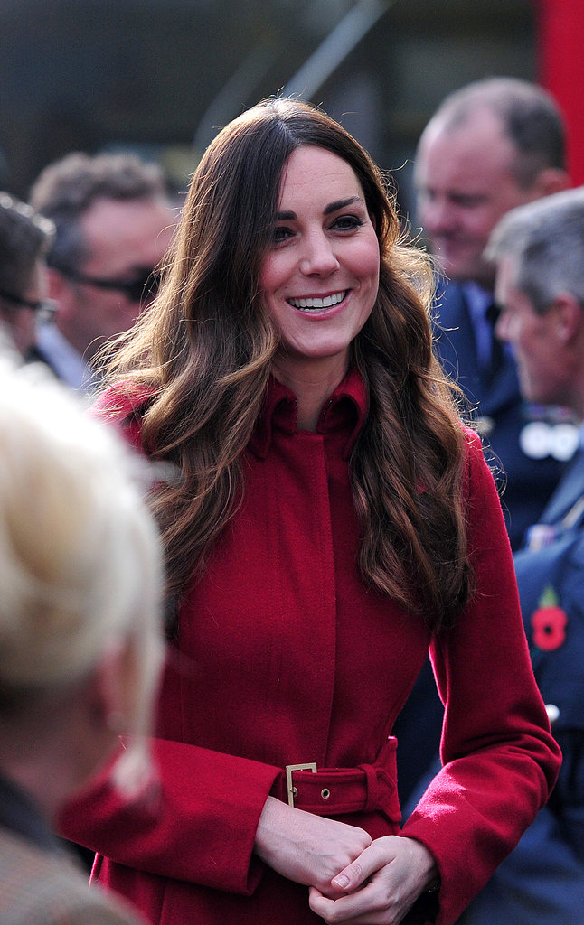 By now, you've probably noticed Kate has a signature look, but she changed it up a bit with a middle part back at the Poppy Day celebration.