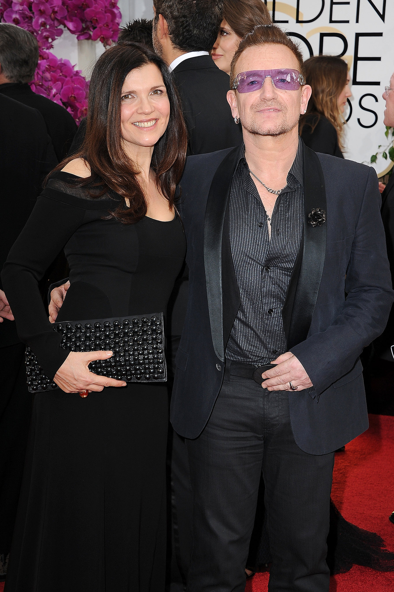 Bono and his wife, Alison, posed for pictures on the red