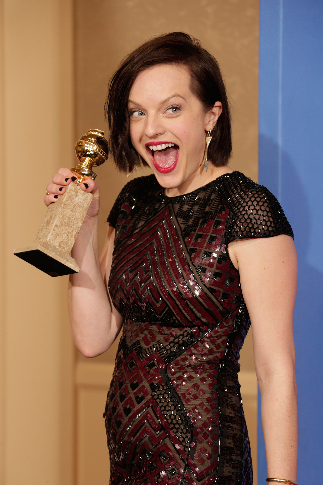 Look, Mom, I won! Elisabeth Moss couldn't have been more excited for her win for Top of the Lake.