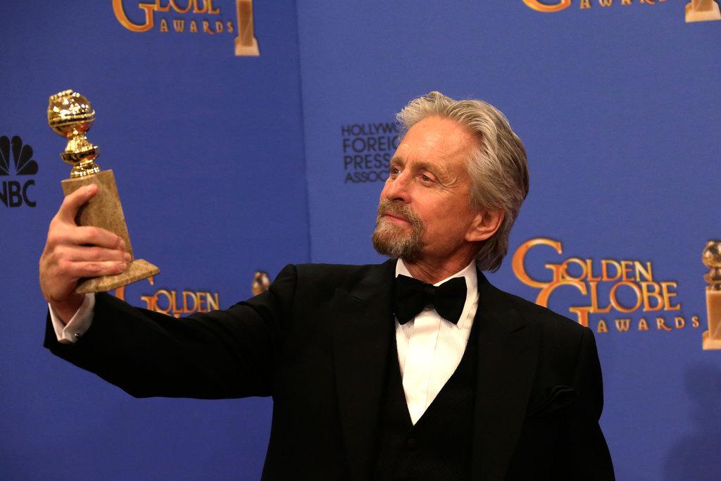 Michael Douglas admired his Golden Globe.