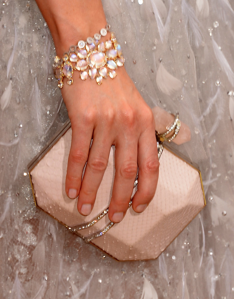 Sarah Paulson picked a pretty pale Marchesa clutch and an armful of Irene Neuwirth jewels.