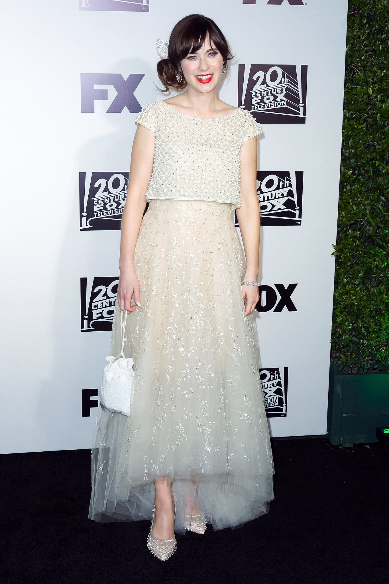 Zooey Deschanel flashed a smile.
