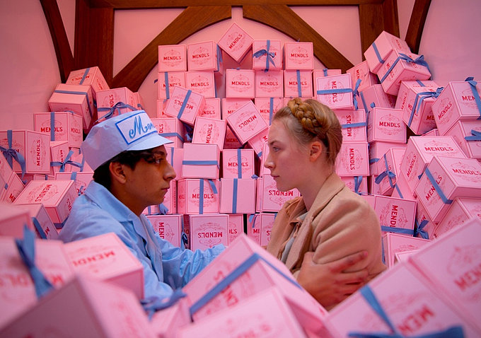 Lobby boy Zero Moustafa (Tony Revolori) steals a moment with Agatha (Saoirse Ronan).