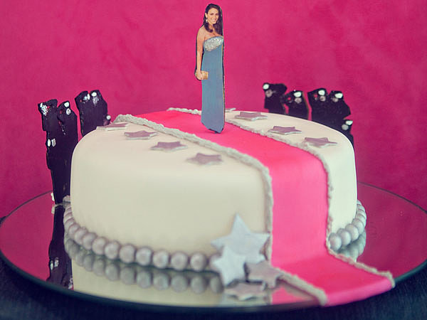 The star-adorned cake (by Gabriela Xacur of Gourmet Sweets) featured a cutout of the bride-to-be strutting her stuff on a pink carpet. Surrounded by paparazzi, naturally.