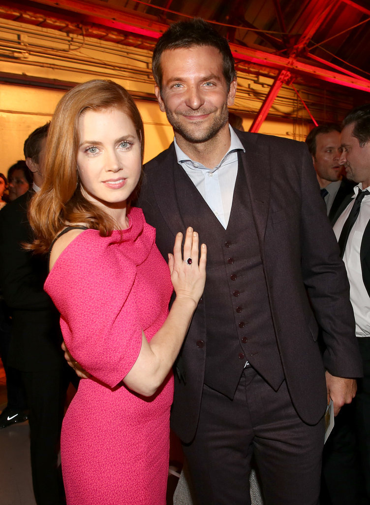 Amy and Bradley Cooper leaned in for a photo.