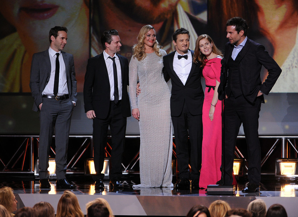 Amy and her costars smiled on stage.