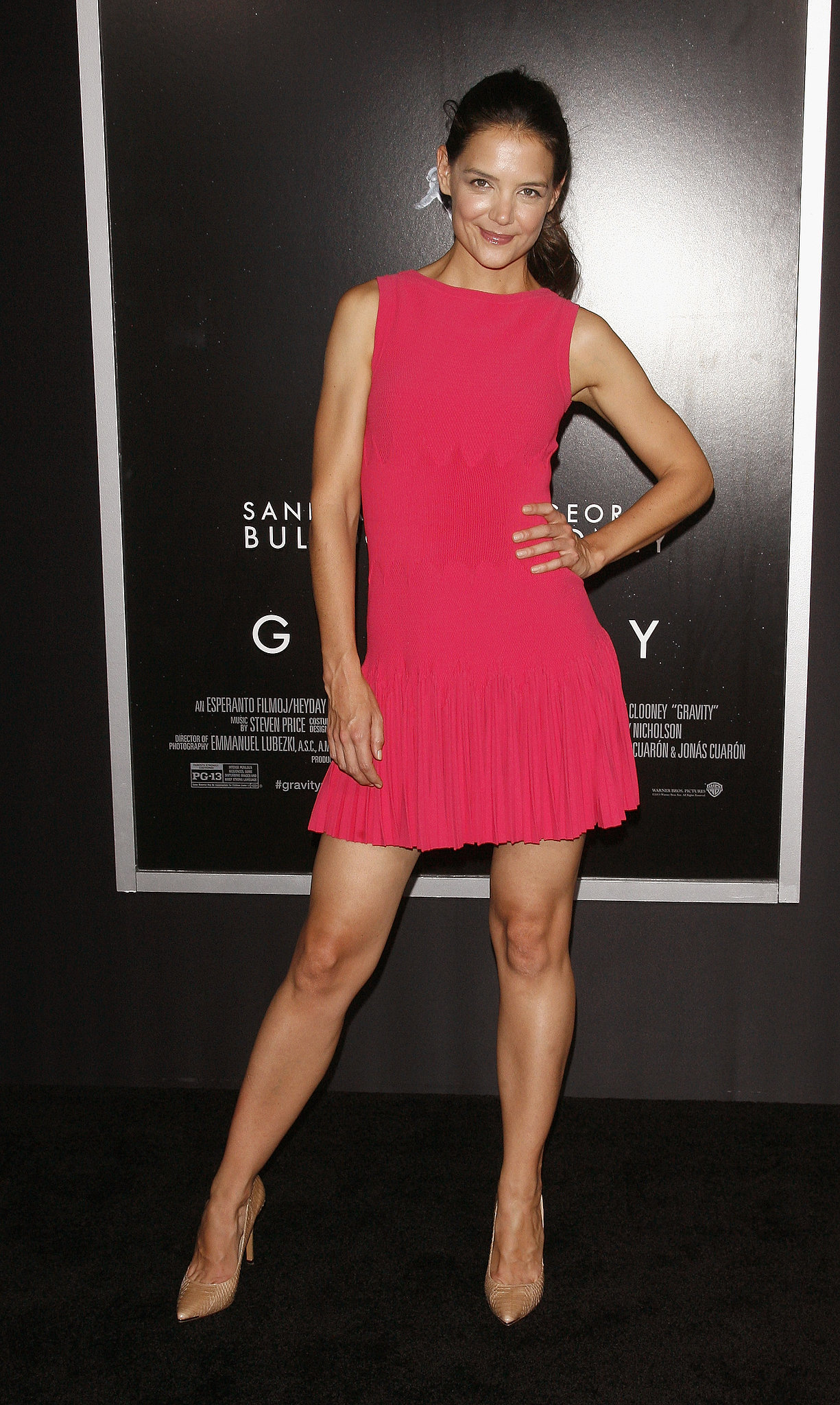 For the NYC premiere of Gravity, Katie Holmes popped in a bright pink pleated minidress by Azzedine Alaïa. Where to Wear: