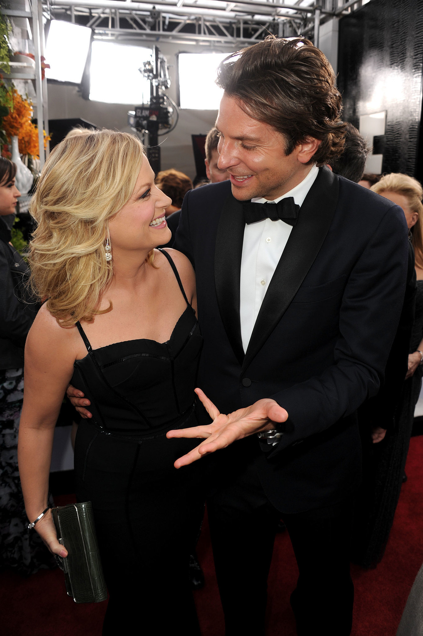Amy Poehler and Bradley Cooper laughed it up on their way into the 2013 SAGs.