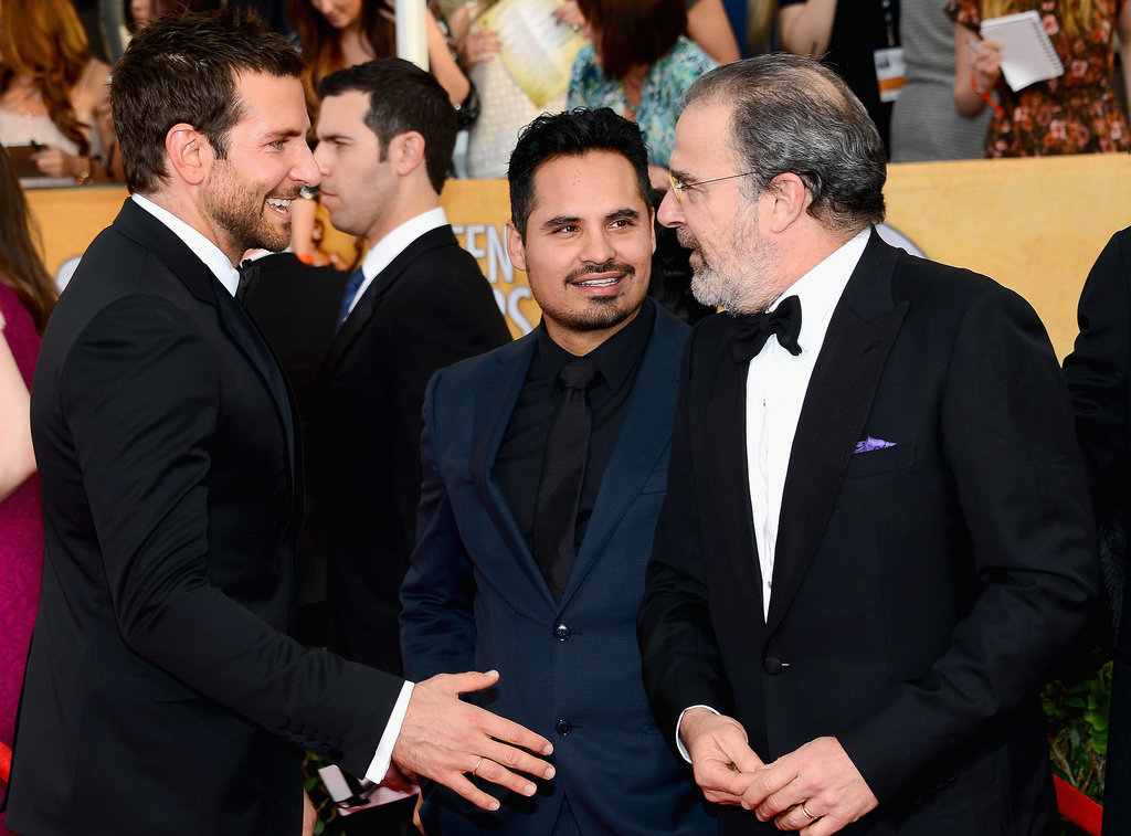 Bradley Cooper stopped to say hi to Michael Peña and Mandy Patinkin.