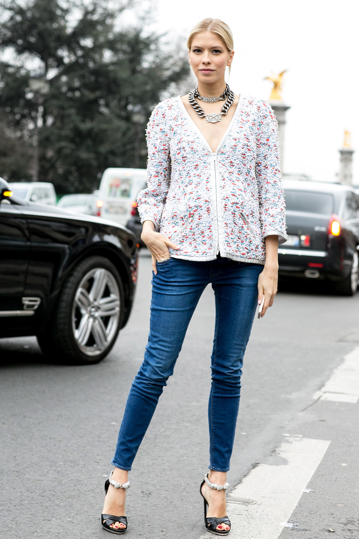 Elena Perminova's modern formula for updating the cardigan? Add skinny jeans and statement jewels.