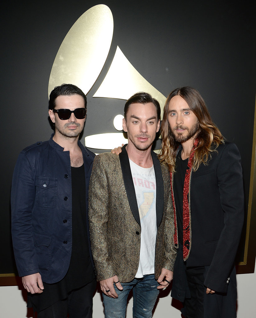 Jared posed with his Thirty Seconds to Mars bandmates: his brother, Shannon, and Tomo Milicevic.
