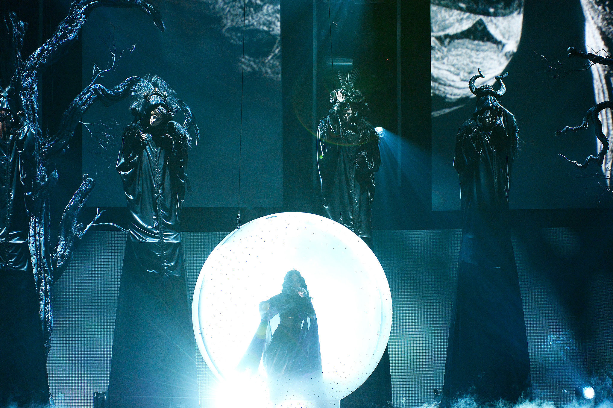 Katy Perry emerged from an illuminated ball.