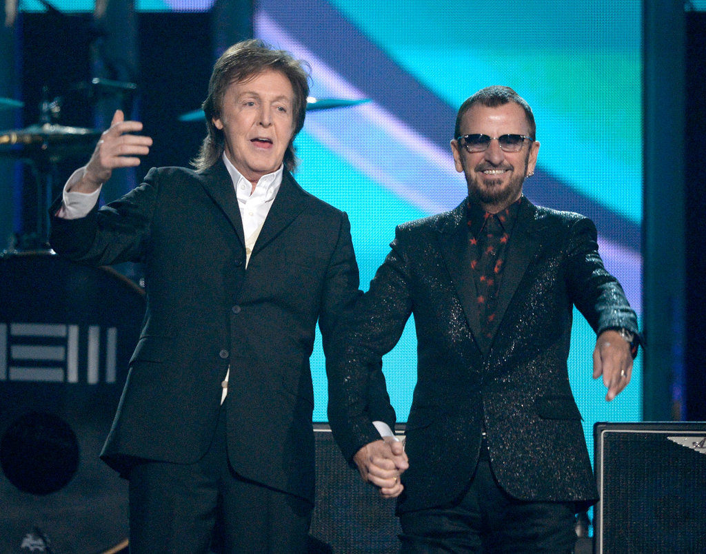 Paul McCartney and Ringo Starr held hands after their performance.