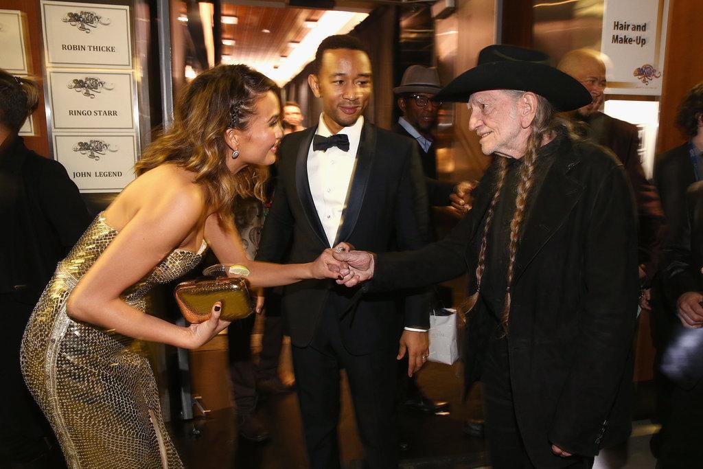 Chrissy Teigen shook Willie Nelson's hand.