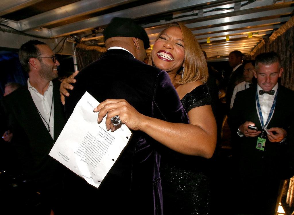 Queen Latifa gave LL Cool J a huge hug.