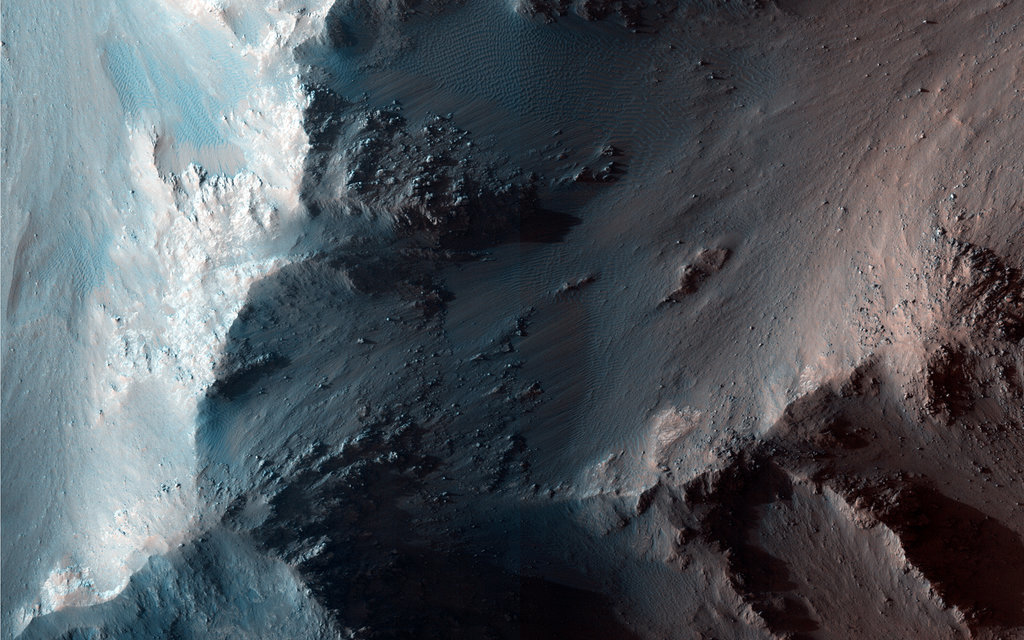 """This site along a Coprates Chasma ridge shows what are called recurring slope lineae (or RSL) on generally north-facing slopes in northern Summer/southern Winter."" Source: NASA/JPL/University of Arizona"