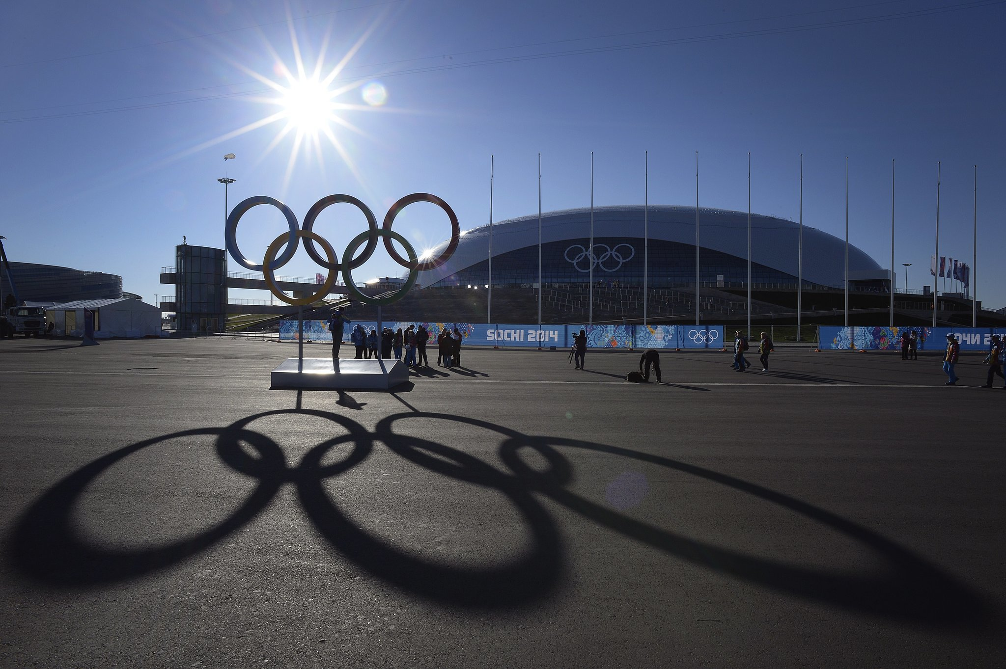 "Source: Getty/Alexander Nemenov   You'll be hearing a lot about the host city. Sochi is a resort city that sits on the Black Sea. Sports venues are set up in two different areas of the city, and in total, it's costing about $50 billion to host the Games there. That's four times the 2007 estimate by Russian President Vladimir Putin. The 2010 Games in Vancouver, British Columbia, Canada, only cost $7 billion. So are the Olympics safe? Russian authorities are combing areas in and around Sochi looking for potential ""black widows,"" suicide bombers named after the deadly spiders. This breed of terrorist is made up of women who are avenging the deaths of their husbands, sons, or brothers who have been killed by Russian security forces. Russia says it has the situation well under control, but some US athletes are asking their families to stay home. If you're all about social media, then go ahead and follow all these Olympians on Instagram. And you'll want to download these essential apps for the Games, too. NBC is airing most high-level events live this year and then repackaging them for primetime. Set your DVRs now for this: ladies' short-program figure skating on Saturday, Feb. 8, at 11:10 a.m. EST and men's USA vs. Russia ice hockey on Saturday, Feb. 15, at 7:30 a.m. EST. If you're planning a viewing party, here are some sporty home goods that capture the Olympic spirit as well as patriotic pieces that are actually pretty cute. Once again, Ralph Lauren designed the Team USA uniforms. They have an awesome, not-so-ugly Christmas-sweater vibe going on."