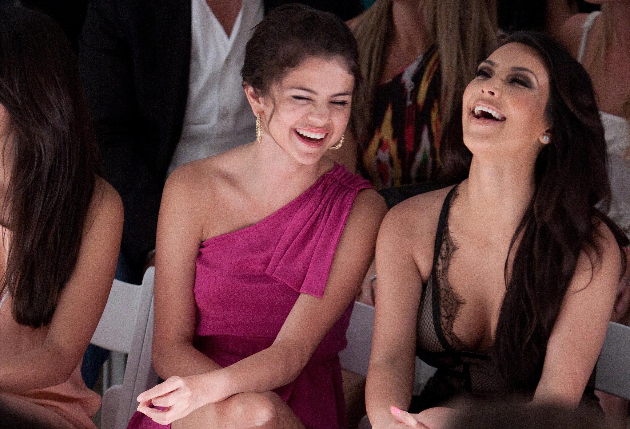 Selena Gomez and Kim Kardashian laughed in July 2010 at Miami Fashion Week.
