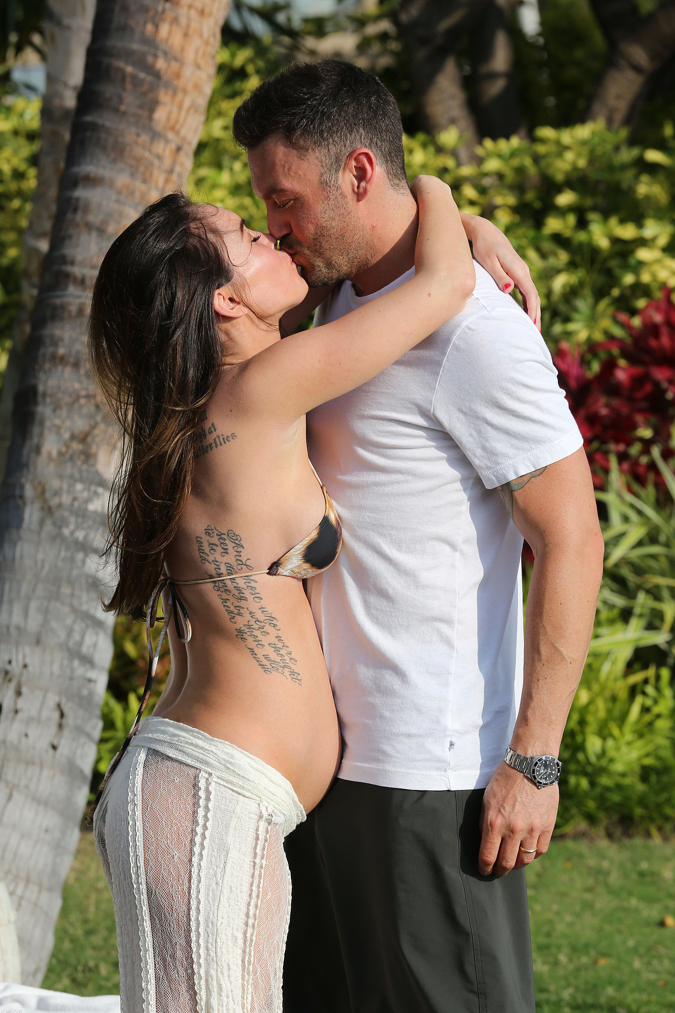 Pregnant Megan Fox planted a passionate kiss on Brian Austin Green on an escape to Hawaii in June 2012.