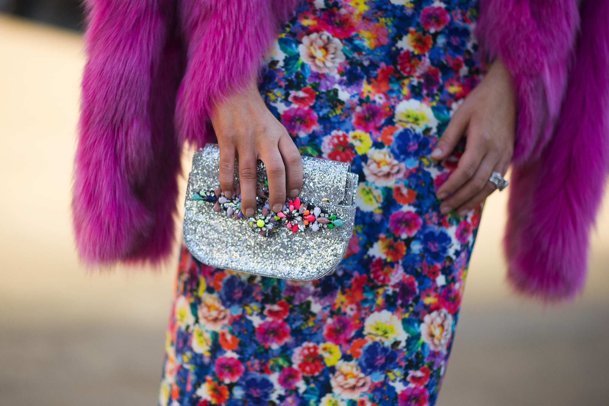 The multicolored embellishments on her clutch upped the ante on her rainbow-bright floral print.