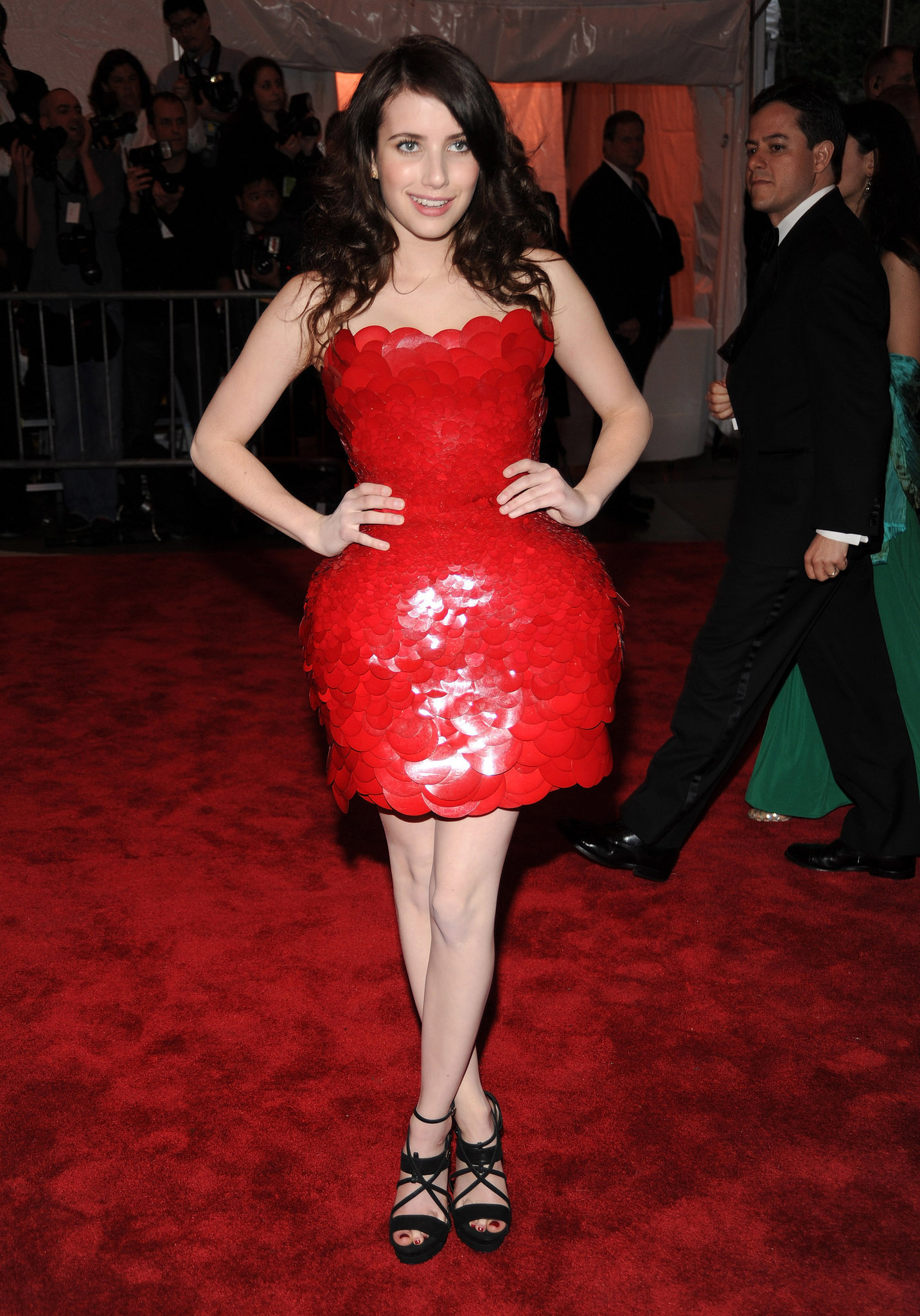 Emma opted for a statement-making red Atelier Versace strapless at the Met Gala in 2009.