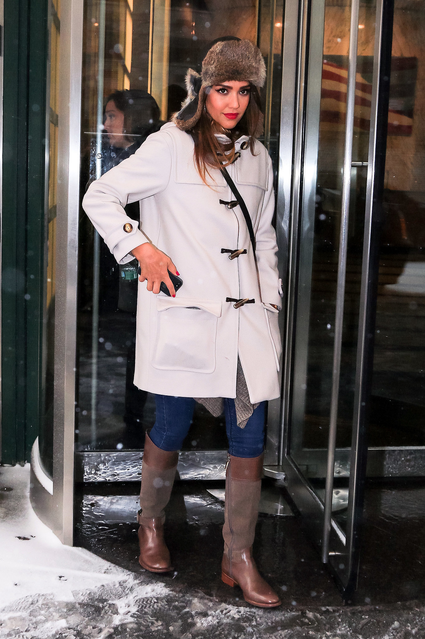 During a chilly NYC outing, Jessica bundled up in a cream toggle coat, Tory Burch riding boots, and a fur trapper.