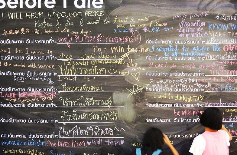 A palliative care organization teamed with a local hospice to post this wall in Bangkok, Thailand, last year outside one of the city's biggest malls to help people peacefully reflect on the end of life.   Photo courtesy of BeforeIDie.com