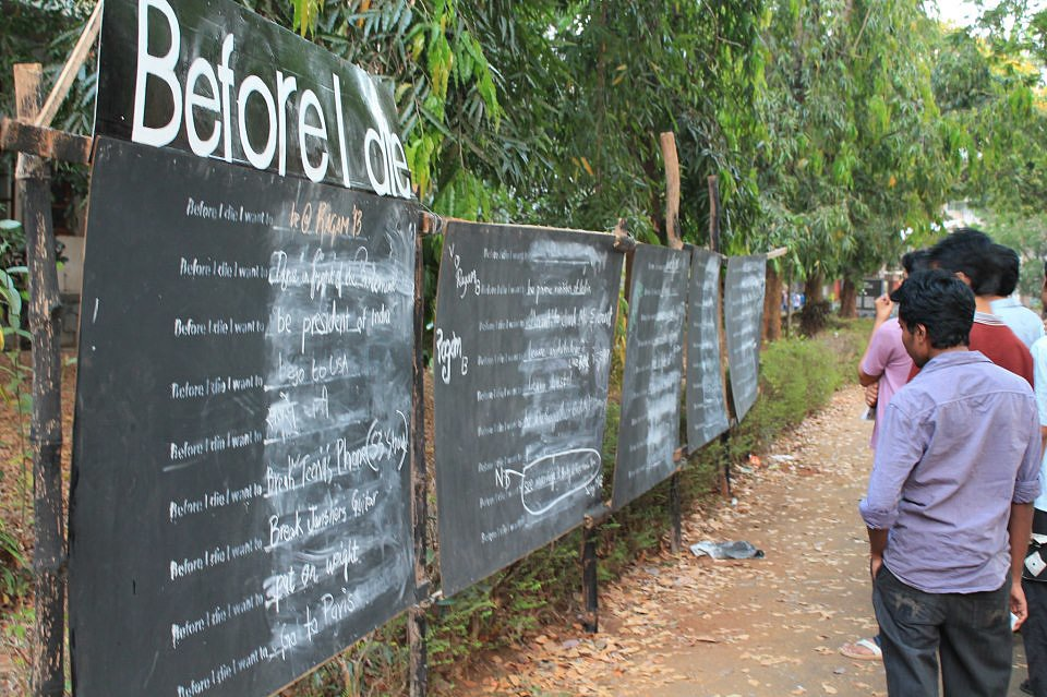 College students in Calcutta, India, posted this board on campus last March. Photo courtesy of BeforeIDie.com