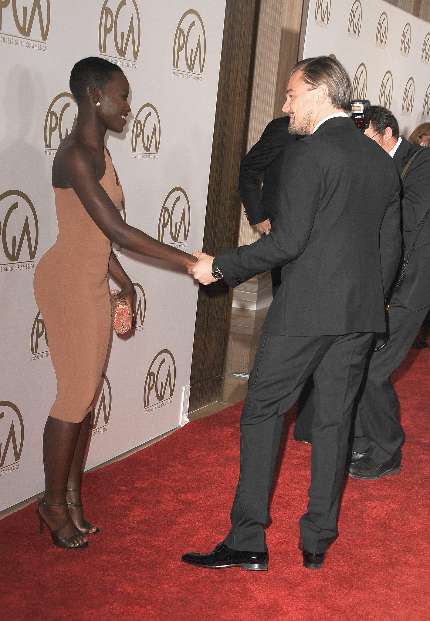 She shared a cute moment with Leonardo DiCaprio on the red carpet at the Producers Guild Awards.