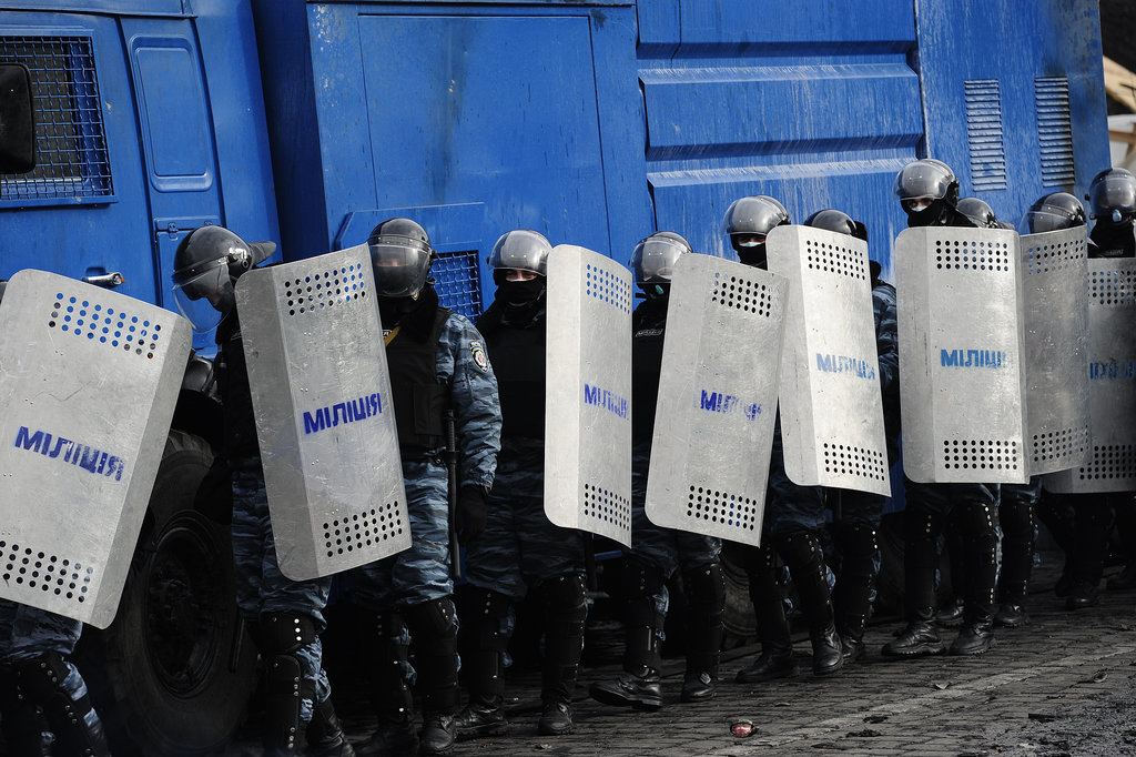 The police held up metal shields.