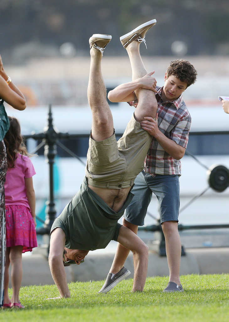 Nolan Gould tried to help Ty Burrell do a handstand on Feb. 20.
