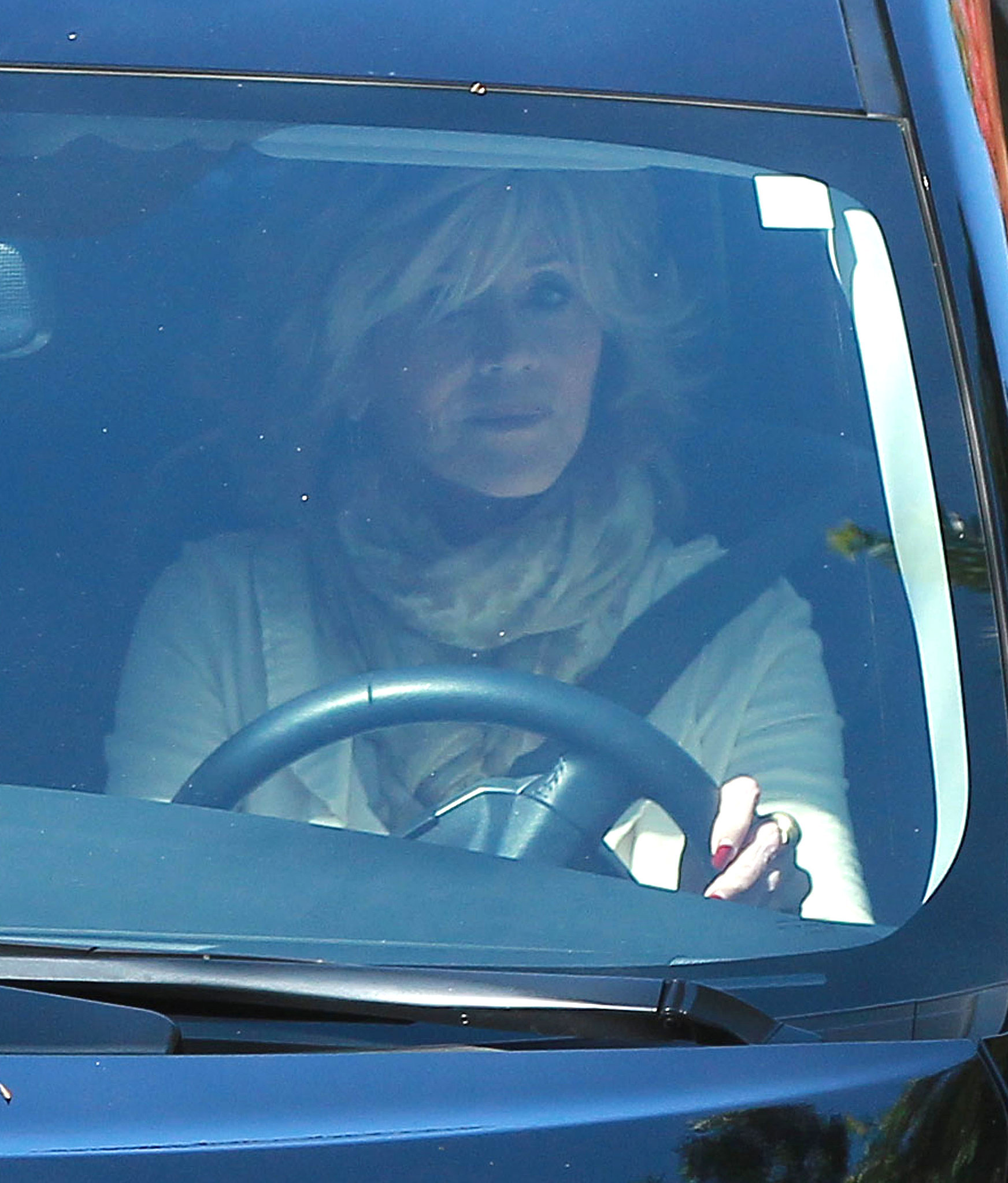 Jane Fonda arrived at the party in her car.