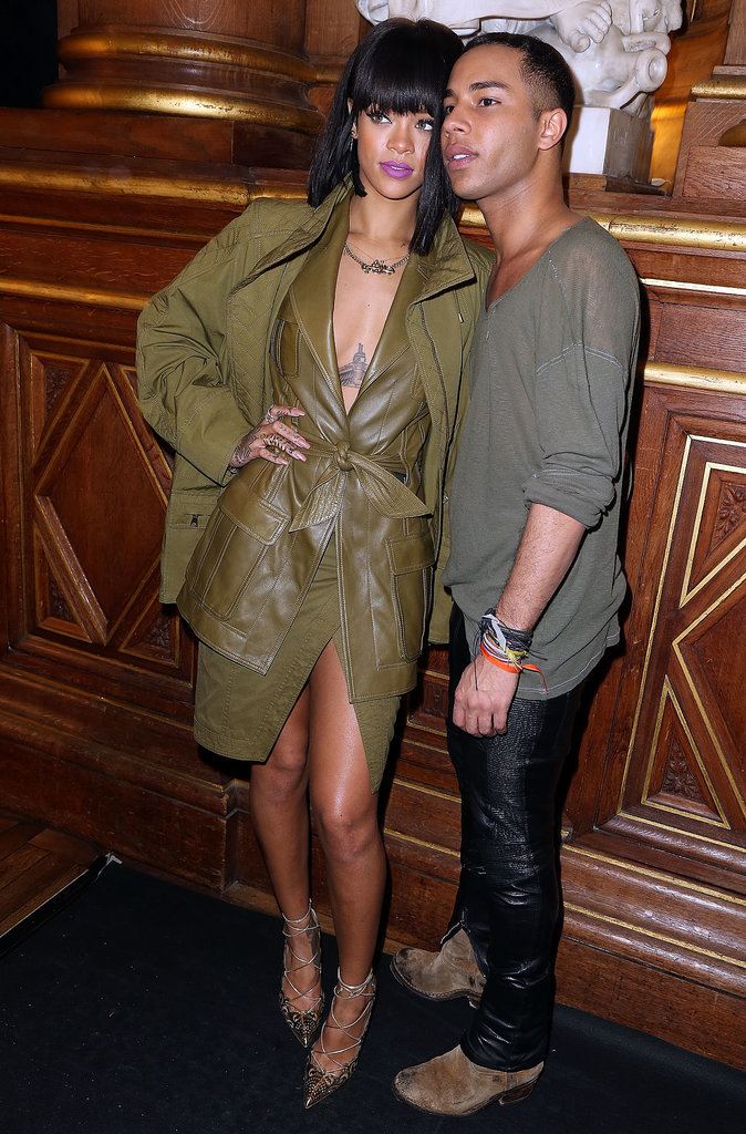 Rihanna popped up in Paris on Wednesday to attend the Balmain show and pose for photos with designer Olivier Rousteing.