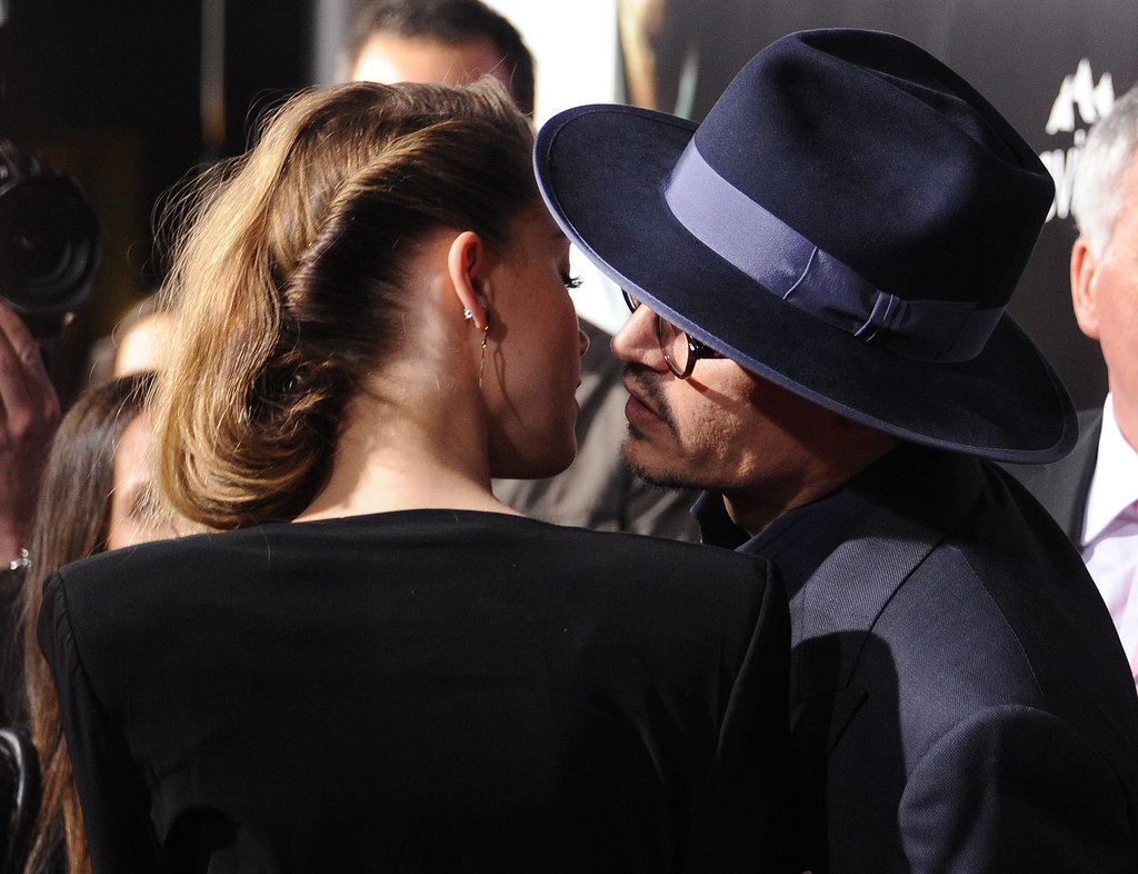 Recently engaged couple Johnny Depp and Amber Heard had a rare moment of PDA at her 3 Days to Kill premiere.