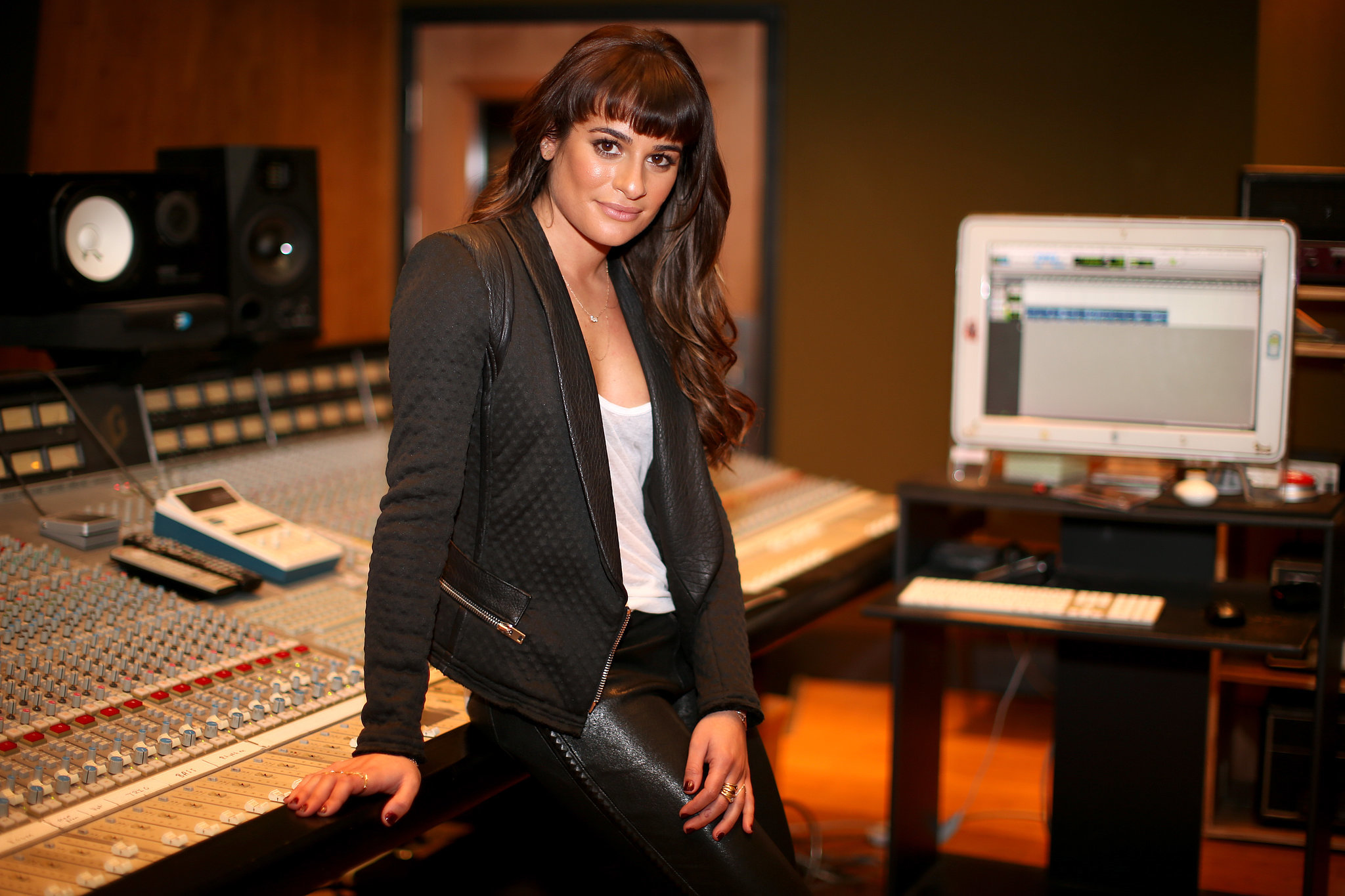 Lea posed for a snap on the recording studio control board.