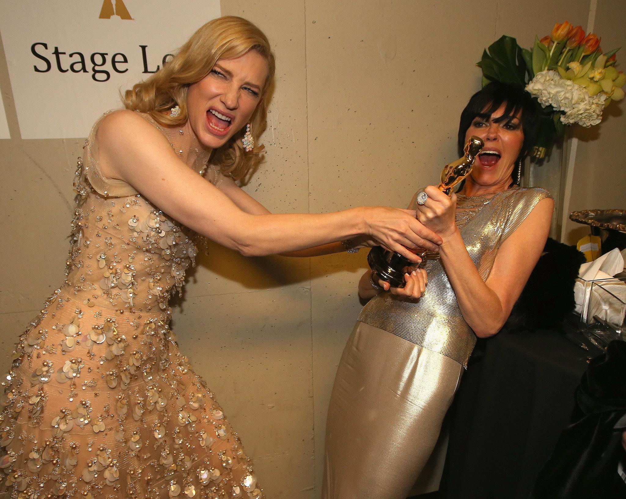 Cate Blanchett joked around with her gold statue.