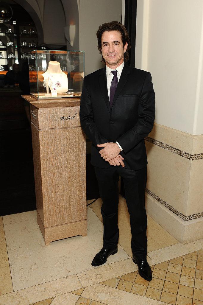 Dermot Mulroney wore a sleek black suit.