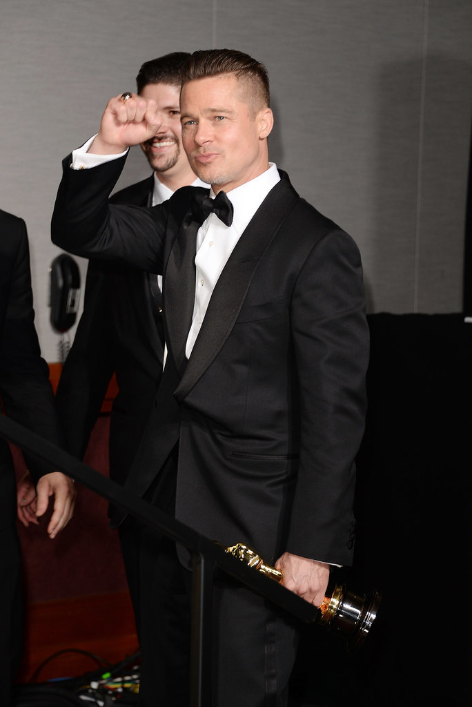 Brad Pitt fist-pumped after winning his first Oscar ever for producing 12 Years a Slave.