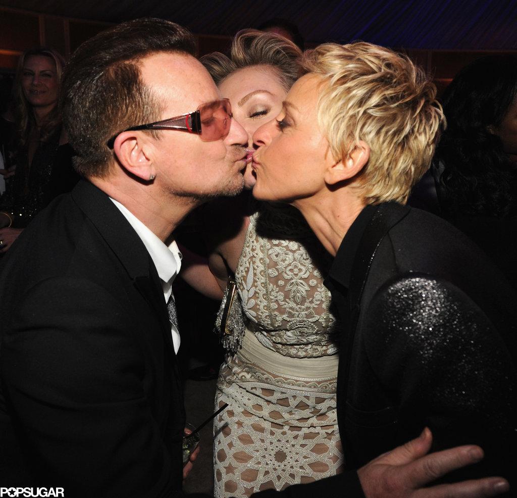 Bono, Portia de Rossi and Ellen DeGeneres locked lips inside the party.