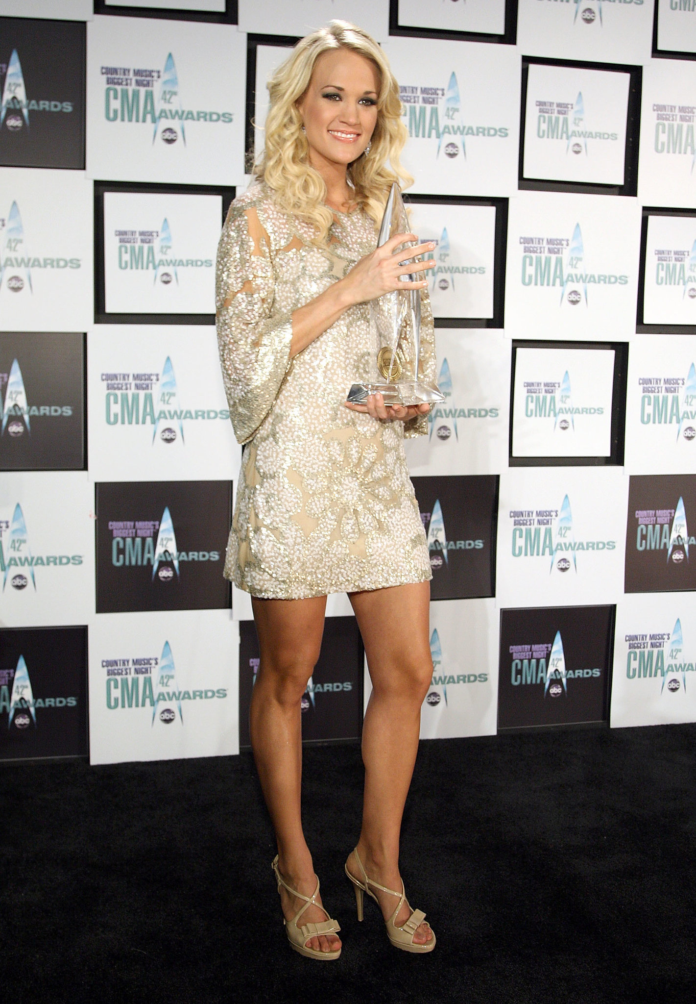 The performer was all smiles while holding her award for female vocalist of the year at the 2008 CMA Awards.