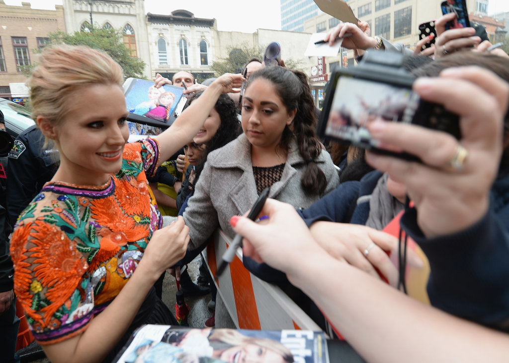 Kristen Bell greeted fans outside the premiere of the Veronica Mars movie.
