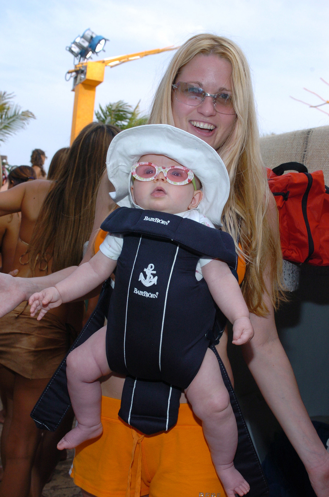 2004: This woman brings her baby to Spring Break in Cancun.